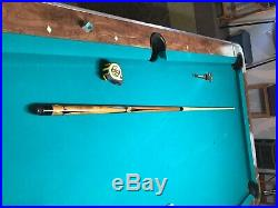 Mcdermott pool cue with no markings except a Mcdermott bumper